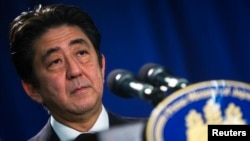 Japanese Prime Minister Shinzo Abe speaks at a news conference in New York, Sept. 27, 2013.