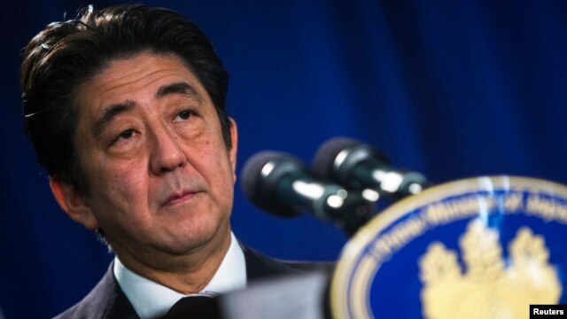 FILE - Japanese Prime Minister Shinzo Abe speaks at a news conference in New York.