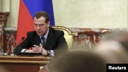 "FILE - Russian Prime Minister Dmitry Medvedev chairs a meeting with members of the government in Moscow, Russia, June 29, 2017. On Thursday, Medvedev announced sanctions against Ukrainian individuals and entities ""to counter Ukraine's unfriendly activities."""