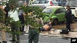 Ahmad Khan Rahami ditangkap setelah terjadi baku tembak dengan polisi, Senin (19/9) di Linden, New Jersey, di barat New York (Moshe Weiss via AP).