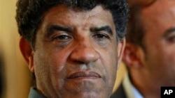Former Libyan intelligence chief Abdullah al-Senussi, shown here Aug. 21, 2011, speaking with reporters in Tripoli, Libya.