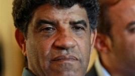 Former Libyan intelligence chief Abdullah al-Senussi, shown here Aug. 21, 2011, speaking with reporters in Tripoli, Libya.