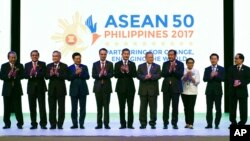 ASEAN Foreign Ministers applaud at the opening ceremony of the 50th ASEAN Foreign Ministers