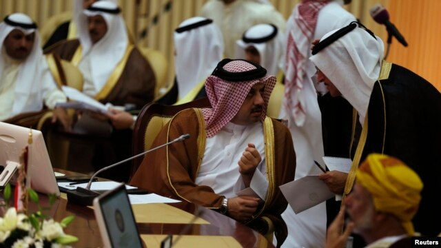 Qatar's Foreign Minister Khalid bin Mohamed Al-Attiyah (L) attends  Gulf Cooperation Council (GCC) meeting in Riyadh June 2, 2014.