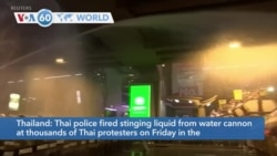 VOA60 Addunyaa - Thai police fired a stinging liquid from water cannons at thousands of Thai protesters