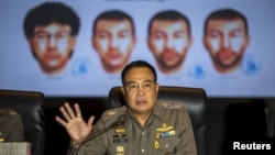 Thai national police chief Somyot Pumpanmuang gestures during a news conference September 28, 2015 about the Bangkok blast as a screen shows the different looks of a suspect, who has been referred to both as Bilal Mohammed and Adem Karadag. (REUTERS/Athit Perawongmetha)