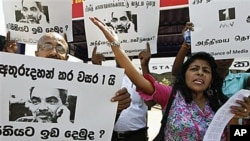 Sri Lankan media rights activists shout slogans during a protest in Colombo, Sri Lanka. Media rights groups' members demanded the government to inquire into the attacks and killings of journalists and punish the culprits, January 18, 2011.