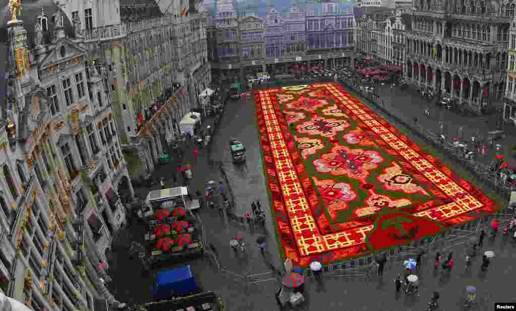 A giant flower carpet is seen at Brussels' Grand Place, Belgium. This year's theme for the flower carpet is Turkey and around 750,000 begonias were used to create the 1,800 square meter flower carpet design, according to the event organizers.