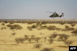 FILE - A Tigre helicopter of France's Barkhane mission in central Mali, is seen as the G5 Sahel anti-jihadist force began operations Nov. 1, 2017.