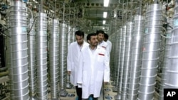 A handout picture released by the official website of Iran's presidency office shows Iranian President Mahmoud Ahmadinejad visiting the Natanz uranium enrichment facility (File)