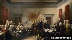 """Slika Džona Trambula """"Deklaracija o nezavisnosti"""" je ulje na platnu veličine 3 x 5. Slika se nalazi u zgradi američkog Kongresa. Slika prikazuje predaju nacrta Deklaracije o nezavisnosti Kongresu."""