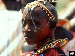 A young Massai woman in traditional dress
