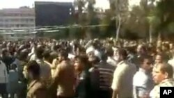 The above photo, obtained by AFP through a third-party source, is said to depict protesters in Deraa, Syria, March 18, 2011