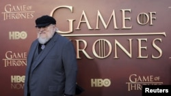 "FILE - Co-executive producer George R.R. Martin arrives for the season premiere of HBO's ""Game of Thrones"" in San Francisco, California."