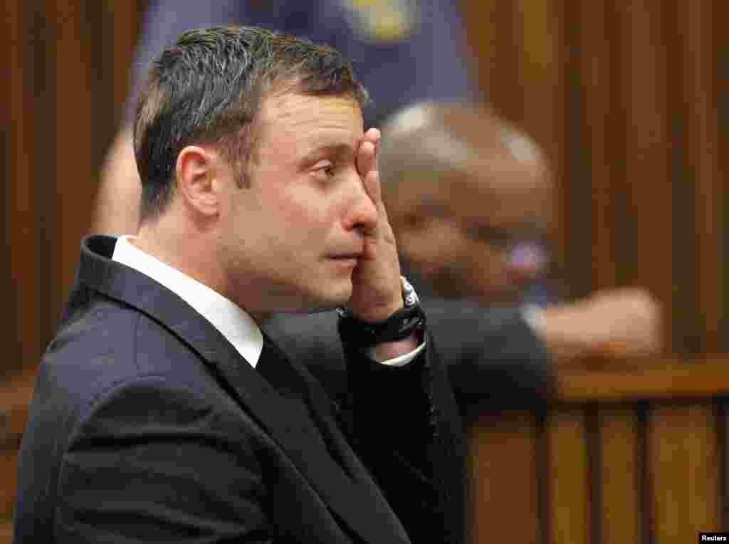 Oscar Pistorius reacts as he listens to Judge Thokozile Masipa's verdict at the North Gauteng High Court in Pretoria, Sept. 11, 2014.