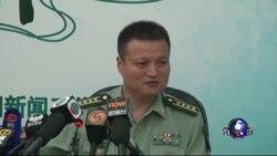 中国军方重申南中国海立场:猎枪迎豺狼