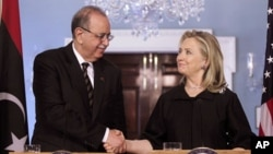 Secretary of State Hillary Clinton shakes hands with Libya's Prime Minister Abdurrahim el-Keib, March 8, 2012, at the State Department in Washington
