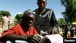 FILE - An elderly woman casts her vote in Malawi's general election in Machinga district, north of the commercial capital, Blantyre.