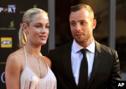 FILE - South African Olympic athlete Oscar Pistorius and Reeva Steenkamp at an awards ceremony, in Johannesburg, South Africa, Nov. 4, 2012.