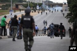 Nigerian police officers patrol in the streets of Abuja during clashes with members of the shiite Islamic Movement of Nigeria on July 22, 2019.