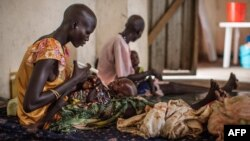 Malnourished children receive treatment at the Leer Hospital, South Sudan, on July 7, 2014.