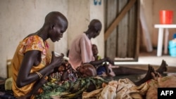 Malnourished children receive treatment at the Leer Hospital, South Sudan, on July 7, 2014. UN humanitarian chief Valerie Amos warned that South Sudan could face famine if seven months of fighting do not end.