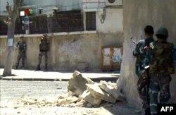 叙利亚电视台画面显示叙利亚安全部队在大马士革作战