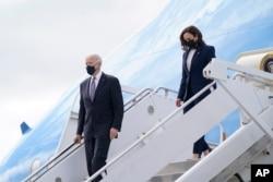 President Joe Biden and Vice President Kamala Harris steps off Air Force One, March 19, 2021, at Dobbins Air Reserve Base in Marietta, Ga.