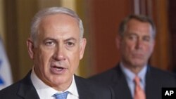 House Speaker John Boehner of Ohio looks on at right as Israeli Prime Minister Benjamin Netanyahu makes a statement on Capitol Hill in Washington, May 24, 2011