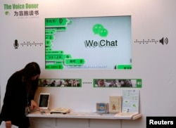 FILE - A counter promoting WeChat, a product of Tencent, on reading books for the blind, is displayed at a news conference announcing the company's results in Hong Kong, March 18, 2015.