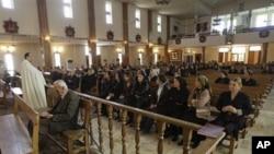Iraqi Christians attend a mass at St. Joseph's Chaldean Church an Eastern Rite church affiliated with the Roman Catholic Church, in Baghdad, Iraq (File Photo)