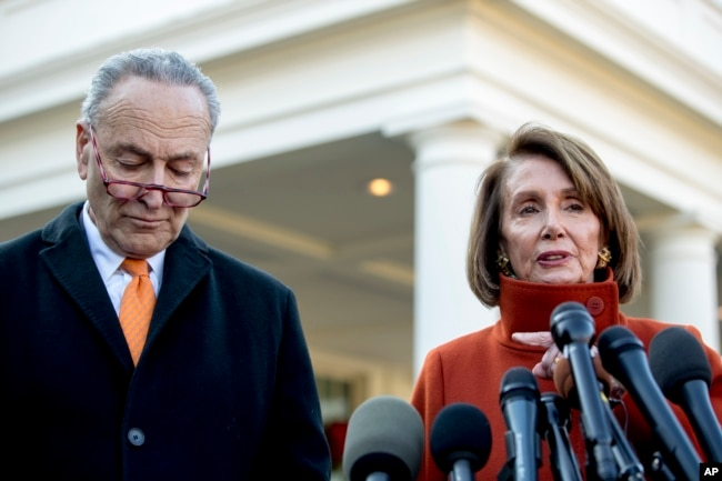 FILE - House Minority Leader Nancy Pelosi of Calif., right, accompanied by Senate Minority Leader Sen. Chuck Schumer of N.Y., left, speaks to members of the media outside the West Wing of the White House in Washington, Dec. 11, 2018.