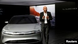 FILE - Derek Jenkins, VP of Design at Lucid Motors, introduces the alpha prototype of the Lucid Air at the 2017 New York International Auto Show in New York City, April 13, 2017.