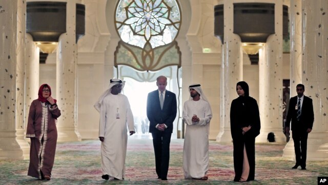 U.S. Vice President Joe Biden (C) visits Sheikh Zayed Grand Mosque in Abu Dhabi, United Arab Emirates, March 7, 2016. Also on Biden's itinerary are Israel, the West Bank and Jordan.