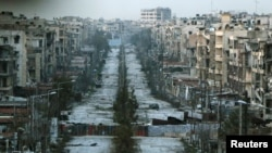 A general view shows a damaged street with sandbags used as barriers in Aleppo's Saif al-Dawla district, Syria, March 6, 2015. The U.S. and Russia say their combined effort to quell unrest in Syria has resulted in a significant decrease in fighting in some areas.