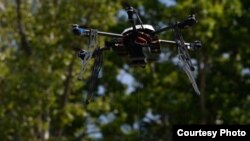 FILE - A Flirtey drones delivers medical supplies in Wise County, Virginia, in the first FAA-approved drone delivery in the U.S. (Flirtey)