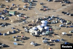 Dakota Access Pipeline protesters are seen at the Oceti Sakowin campground near the town of Cannon Ball, North Dakota, Nov. 19, 2016.