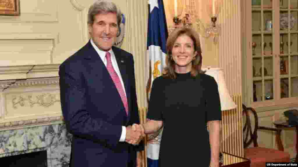Secretary of State John Kerry and U.S. Ambassador to Japan Caroline Kennedy pose for a photo at Ambassador Kennedy's swearing-in ceremony at the Department of State in Washington, DC, on November 12, 2013.