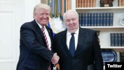 President Donald Trump shakes hands with Russia's ambassador to the U.S., Sergei Kislyak in this photo tweeted by the Russian embassy.