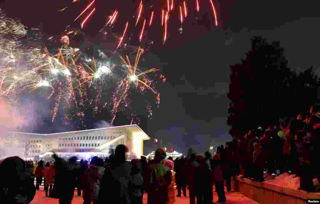 North Koreans watch fireworks to greet new year in Pyongyang early January 1, 2013 in this picture released by the North's official KCNA news agency. REUTERS/KCNA (NORTH KOREA - Tags: SOCIETY ANNIVERSARY) FOR EDITORIAL USE ONLY. NOT FOR SALE FOR MARKE