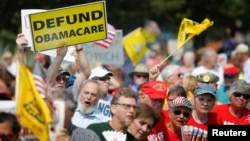 Opponents of President Barack Obama's Affordable Health Care Act rally on the west lawn of the U.S. Capitol in Washington, Sept. 10, 2013.