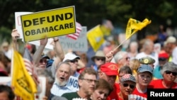 FILE - Opponents of President Barack Obama's Affordable Health Care Act rally near the U.S. Capitol in Washington, Sept. 10, 2013. Republicans in Congress have tried more than 60 times in the past six years to defund the program that now insures 22 million Americans.