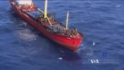 Huge Migrant Ship Docks In Greece as EU Asylum Policy Comes Under Fire