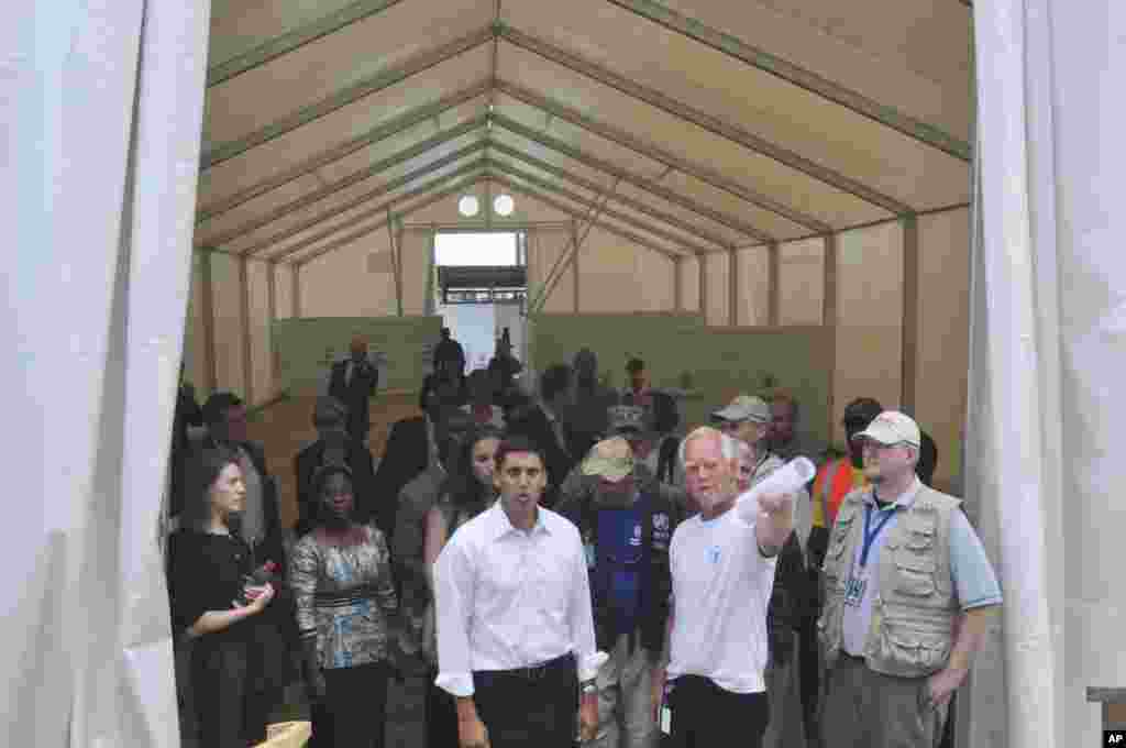 Rajiv Shah, the head of USAID, inspects a newly-built Ebola treatment center in Monrovia, Liberia, Oct. 14, 2014.