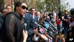 """Marvin Gaye's daughter, Nona Gaye, left, talks to the media outside the Los Angeles U.S. District Court after a jury awarded the singer's children nearly $7.4 million after determining singers Robin Thicke and Pharrell Williams copied their father's music to create """"Blurred Lines,"""" March 10, 2015."""