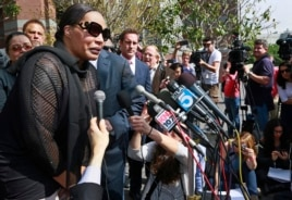 Marvin Gaye's daughter, Nona Gaye, left, talks to the media outside the Los Angeles U.S. District Court after a jury awarded the singer's children nearly $7.4 million in copyright claim, March 10, 2015.