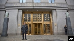 A court officer stands outside U.S. Federal Court, where two nephews of Venezuela's powerful first lady are facing arraignment after being arrested in Haiti, Nov. 12, 2015, in New York.