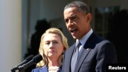 FILE - President Barack Obama delivers a statement alongside then-secretary of state Hillary Clinton, at the Rose Garden of the White House in Washington, Sept. 12, 2012.