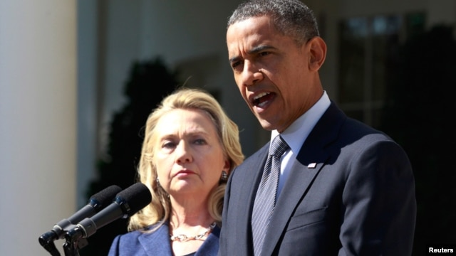 President Barack Obama delivers a statement alongside Secretary of State Hillary Clinton, following the death of the U.S. Ambassador to Libya, Chris Stevens, and others, from the Rose Garden of the White House in Washington, September 12, 2012