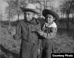"Robert ""Corky"" and Linda Poolaw (Kiowa/Delaware), dressed up and posed for the photo by their father, Horace. Anadarko, Oklahoma, ca. 1947. 45HPF57 © 2014 Estate of Horace Poolaw. Reprinted with permission."